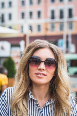 Fashion outdoor portrait of summer hipster woman wearing sunglass