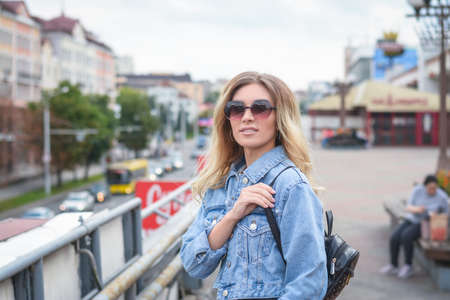 stylish girl in jeans on the street