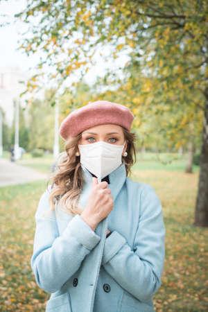 elegant girl in protective mask in autumn park