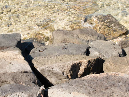 water s edge: Lava Rocks on Water s Edge Stock Photo
