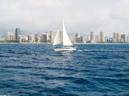 Sailboat in front of Waikiki on a windy day