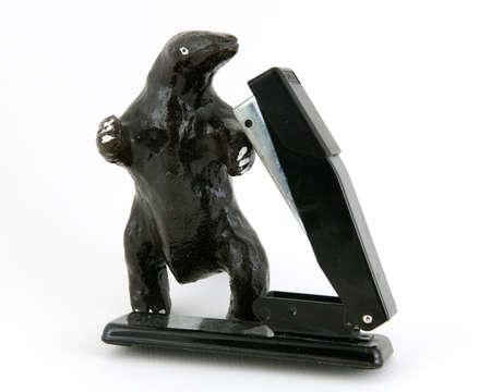 office stapler: Monster and stapler battling on white background