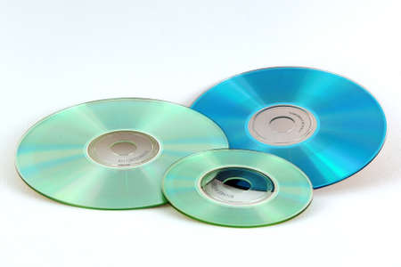Variety of optical discs on white background