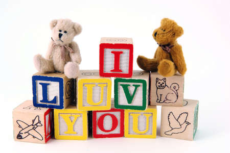Bears sitting on toy blocks spelling I