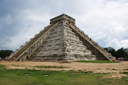 pyramid peak: Mayan pyramid at Chichen-Itza with clouds in the background