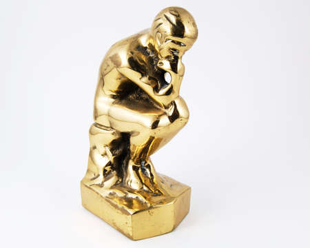 ruminate: Thinking man in brass isolated on a white background Stock Photo