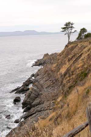 Coastline along the souther tip of Chile with the straits of Magellen in the background Stock Photo
