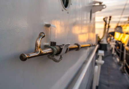 Boat hook stowed on the side of a ship