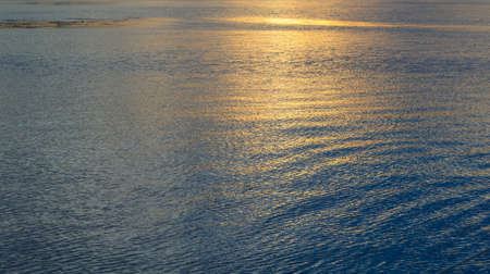Water waves and sunlight reflecting in the ocean Stock Photo