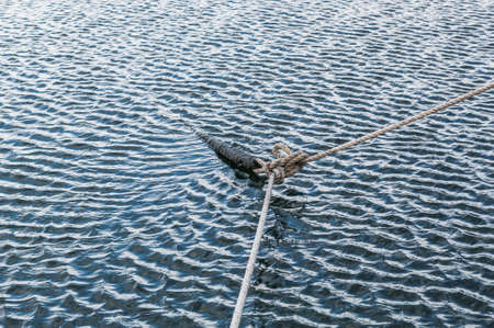 Anchor ropes surrounded by ocean wave texture