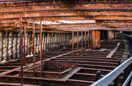 Rusting structure of an abandoned ship with sunlight