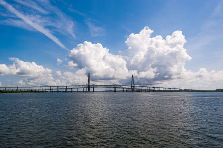 cooper: Arthur Ravenel Jr Bridge over Cooper River in Charleston with dramatic clouds in the background