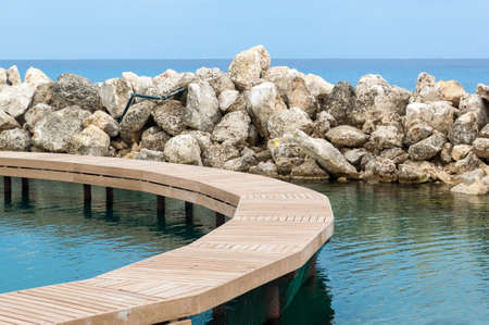 Xcaret walkway showing an ocean horizon and rock jetty Stock Photo