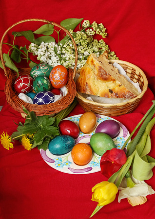 Easter eggs, cake and flowers - red background photo