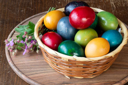 Easter eggs with flowers - wood background
