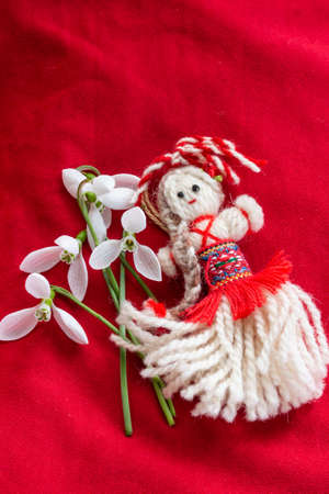 Martenitsa - traditional Bulgarian custom - red background with snowdrops