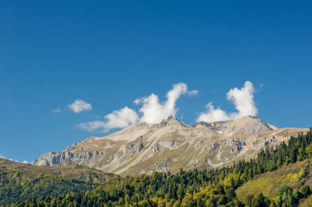 fisht: View of the high ridge of the Caucasus mountains and the forest at the foot of the