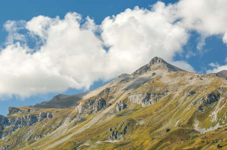plumb: Highest mountain in the Caucasus and clouds on a blue sky