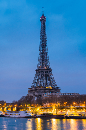 A view of Eiffel tower and seine river at night in winter time of Paris