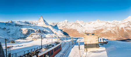 Cogwheel train down from the top of mountain with swiss alps view, Zermatt Switzerland Stock Photo
