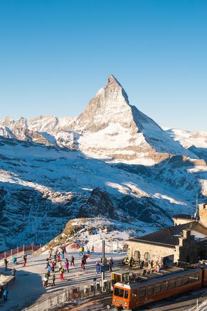 Zermatt, SWITZERLAND - DECEMBER 26, 2016: Skiers and snowboarder were leaving the train prepare to ski at Gornergrat train station with matterhorn peak view at the background of ski track. Editorial