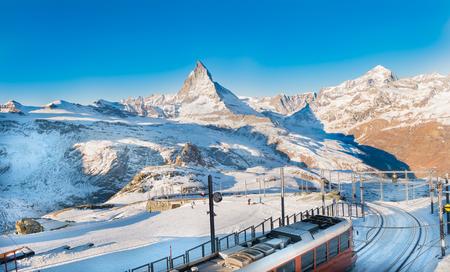 Cogwheel train down from the top of mountain with swiss alps view, Zermatt Switzerland Stock Photo