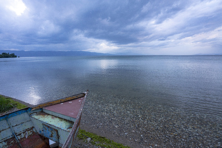 Lake Ohrid landscapes and Boat washed on beach in Macedonia