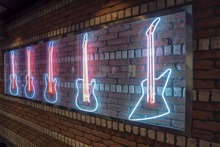 Rock Bar Neon decoration of Guitars on Brick Wall