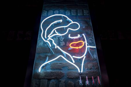 Neon Light in shape of a man in a Rock Bar as decoration