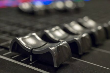 Audio Mixer with Faders pushed up on a Mixer Reklamní fotografie