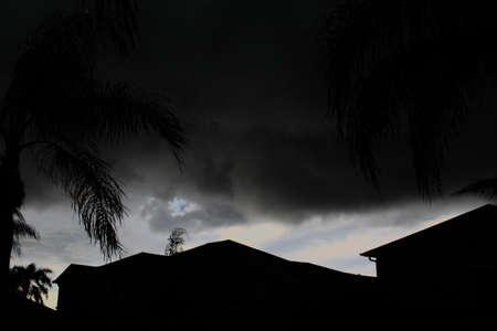 House Sillouhette before a stormy, dark sky