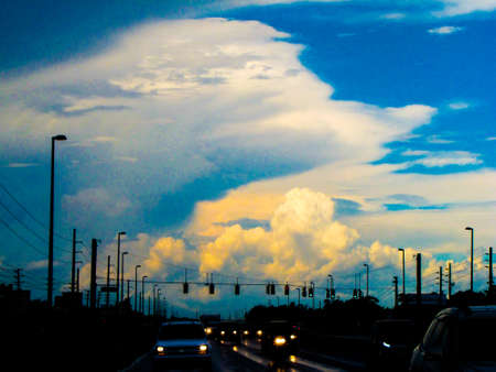 Clouds and nighttime show the the sky above roads. Stock Photo