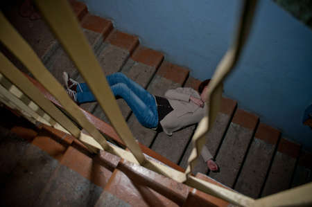youth crime: Girl laying in the staircase