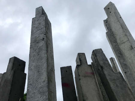 The cement pillars that were arranged vertically were painted in gray tones. Stok Fotoğraf - 131637245