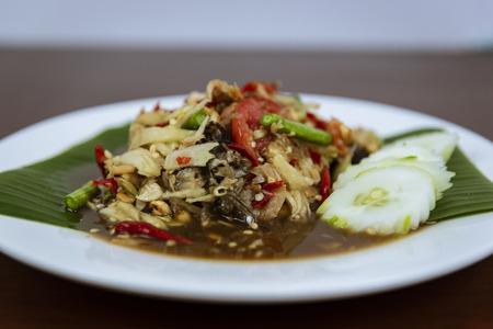 Thai Green Papaya Salad, Som tum Thai spicy on wooden background