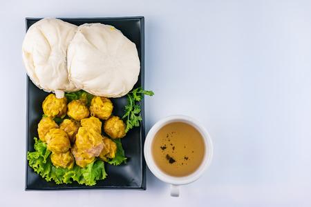 Steamed stuff bun, Chinese steamed dumpling and hot tea