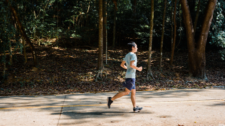 young man runner athlete running  in a park