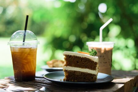 Coffee and cake, afternoon on a wooden table in the garden