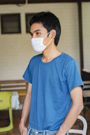 The man wear a mask to protect against the Coronavirus Covid-19.