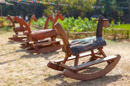 Rocking horse is handmade toys in park, Children like to play fun