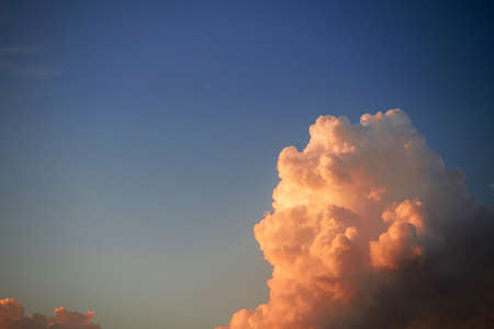 high section: Evening sky with golden clouds in evening time at sunset