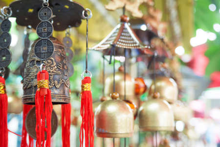 Chinese temple bell hanging in the evening in soft light