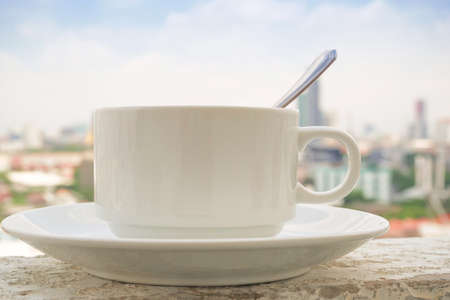 placed: Coffee cup placed on the building in the morning shine day Stock Photo