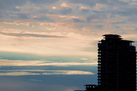 high section: Building on a cloudy evening sky in sunset time