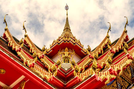 high section: Thailand temple on a cloudy sky with the sun shine at morning