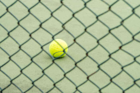 fall protection: Tennis ball in the cage On a green field at sport stadium