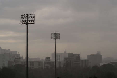 high section: Rain in the evening sky at the stadium in dark sky