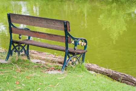time to shine: Chair near the river in the evening sun shine in relax time Stock Photo
