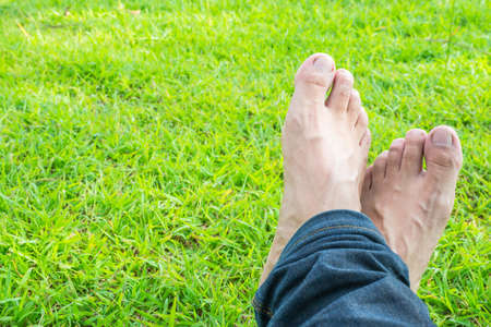 personal perspective: Cross foot on the green grass in the sunshine morning