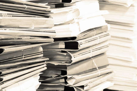 architectural feature: Piles of paper in the office in working time